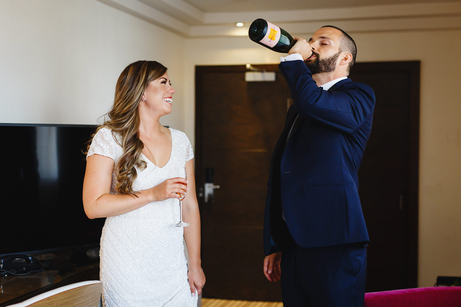 A couple drink Verve Cliquot champagne at The Marylebone Hotel - London wedding photographer