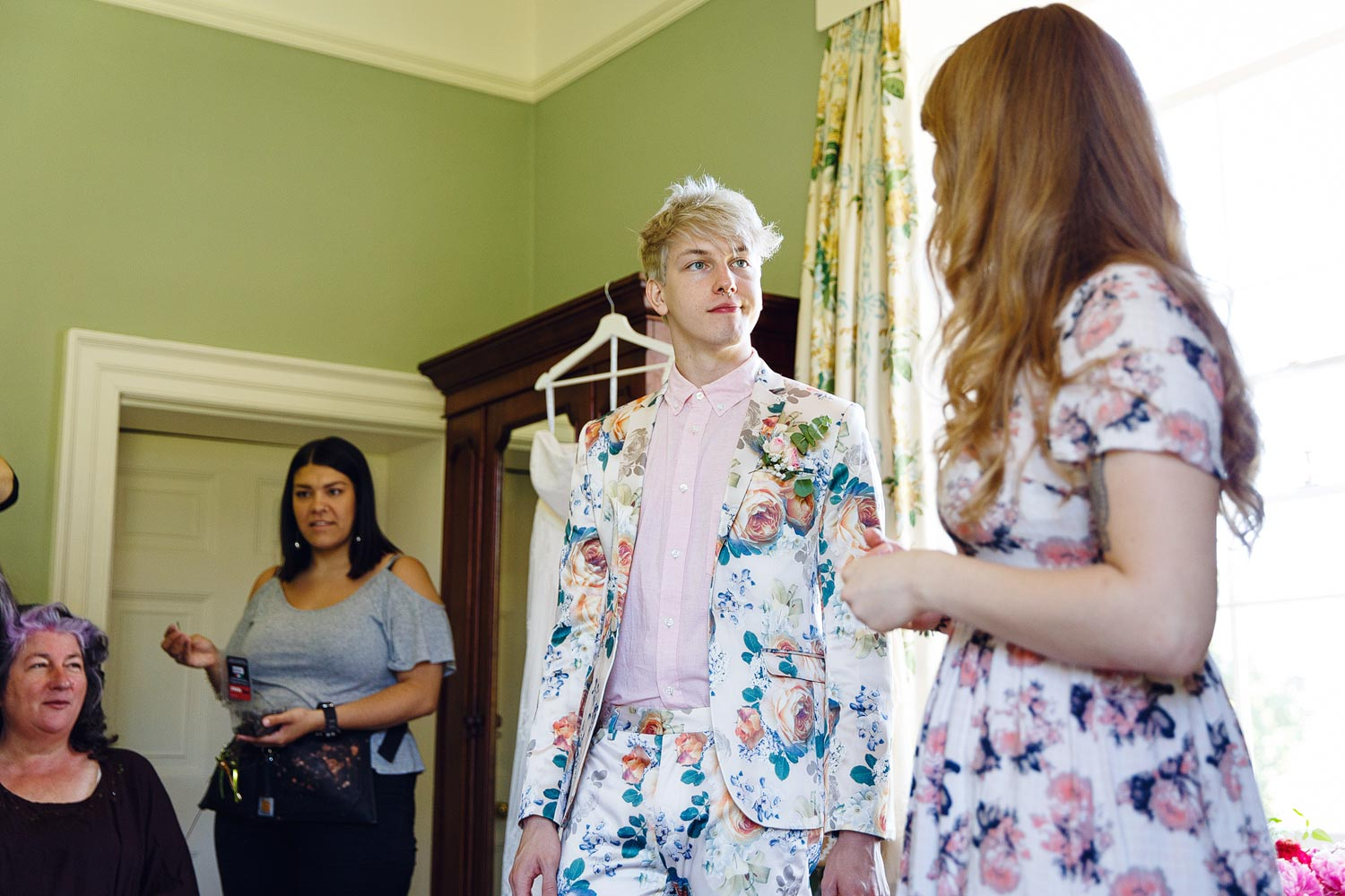 The bridesman wore a floral suit at a wedding at Bressingham Hall