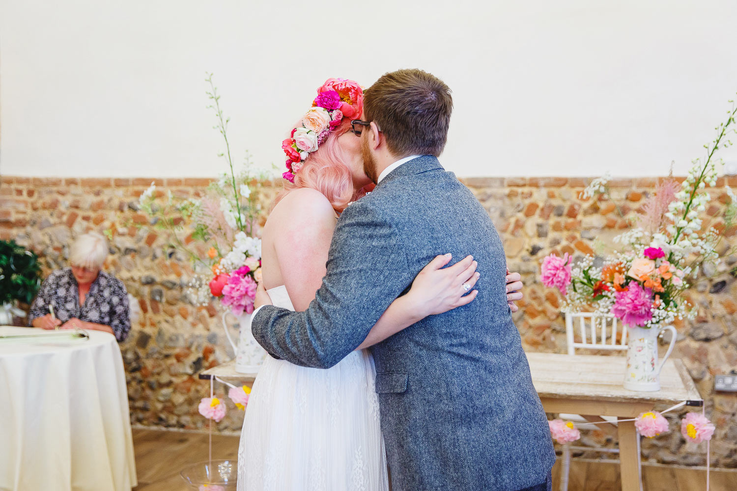 A bride and groom have their first kiss at Bressingham Hall.
