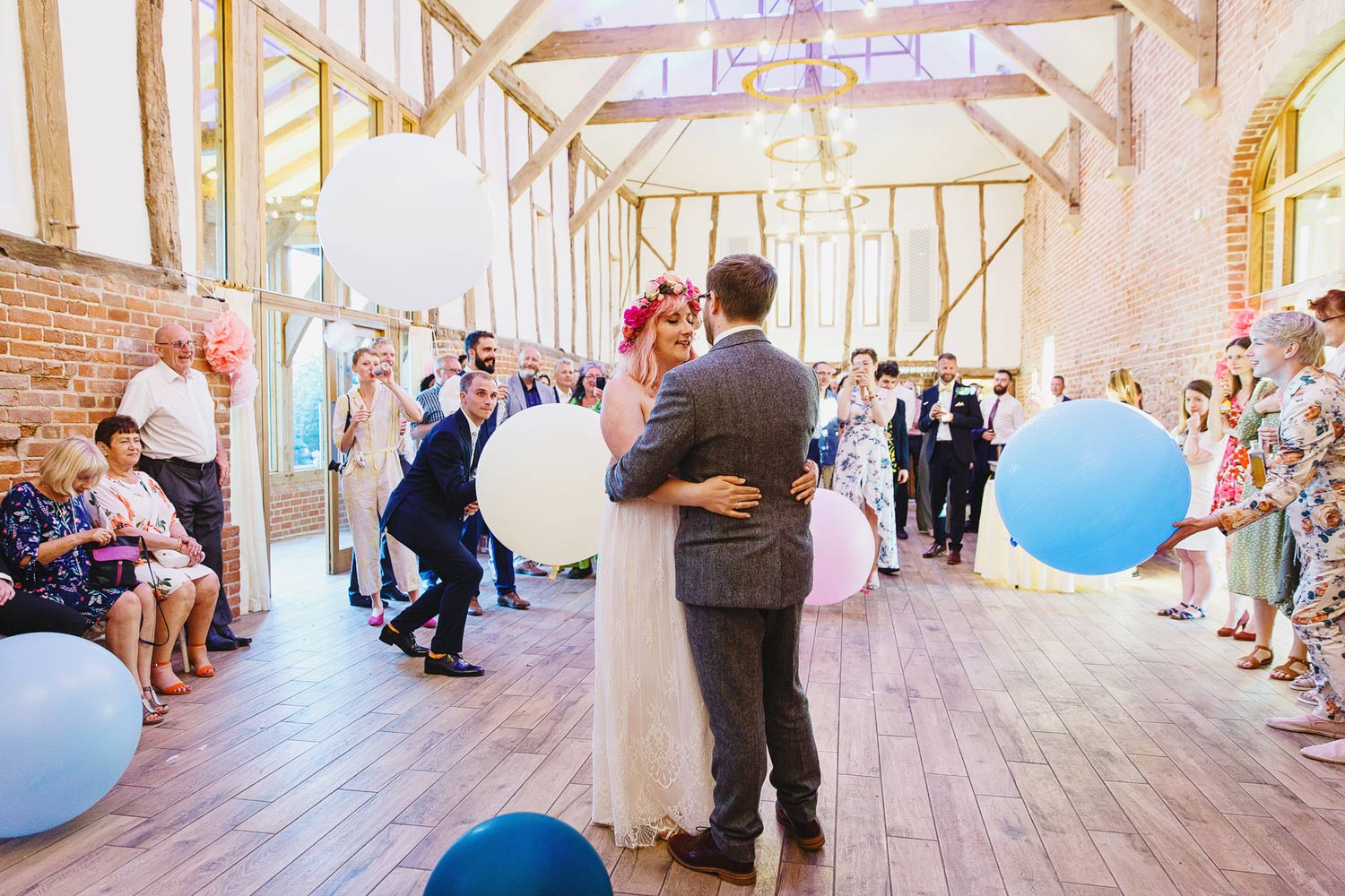 A bride and groom have their first dance at Bressingham Hall