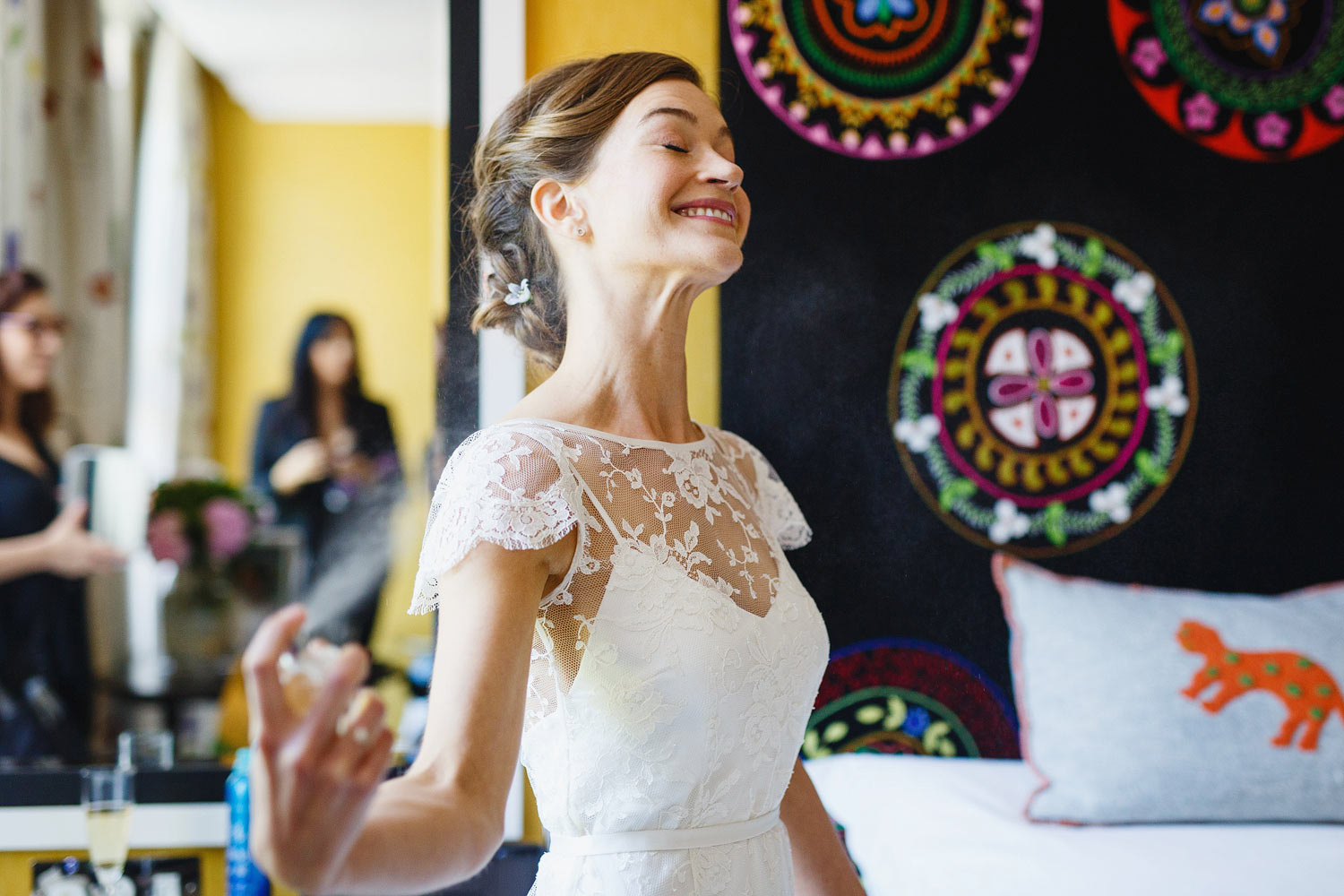 A bride puts perfume on at Dorset Square Hotel - London wedding photographer