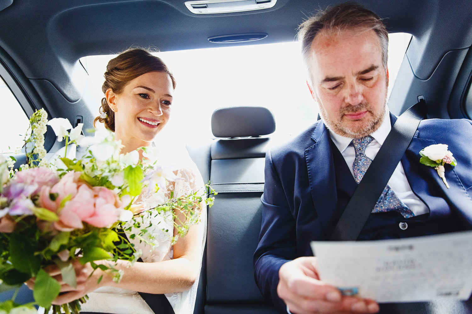 A bride and her father drive to the ceremony at Burgh House Museum - London wedding photographer