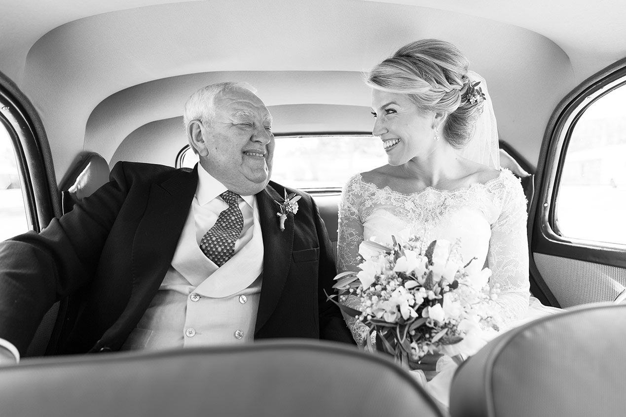 The bride and her father in the car before her Chateau Rigaud wedding in France - French wedding photographer