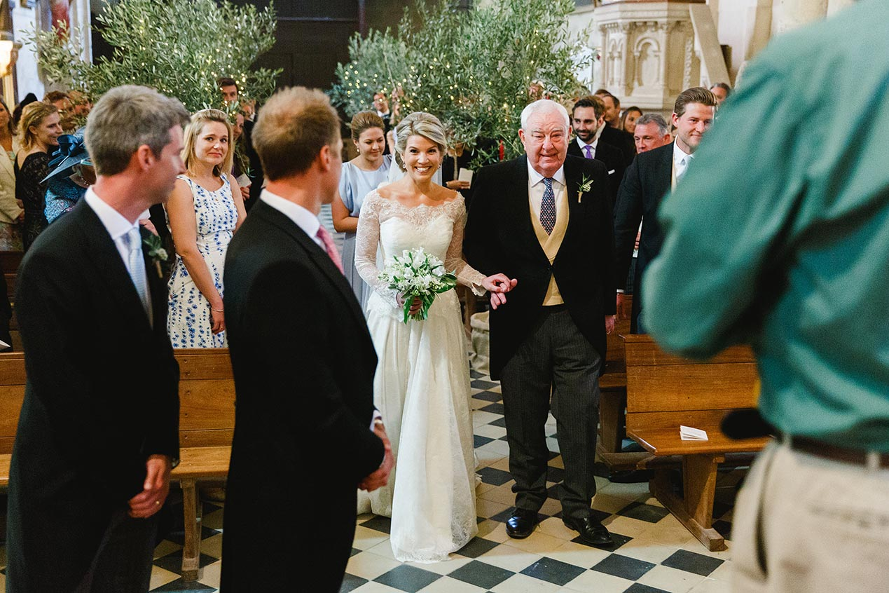 The bride walks down the aisle at her Chateau Rigaud wedding in France - French wedding photographer