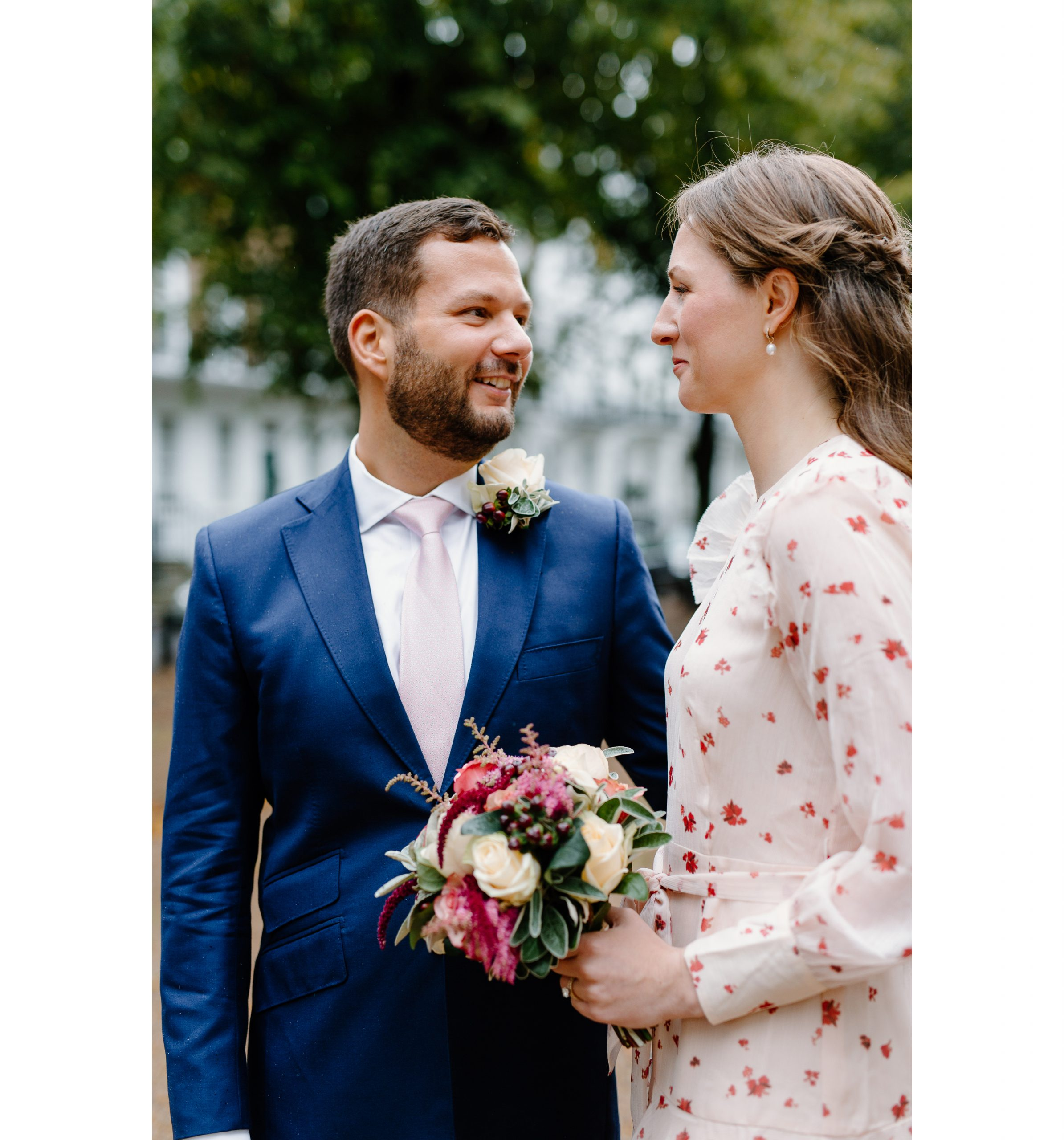 A couple post during their intimate London wedding