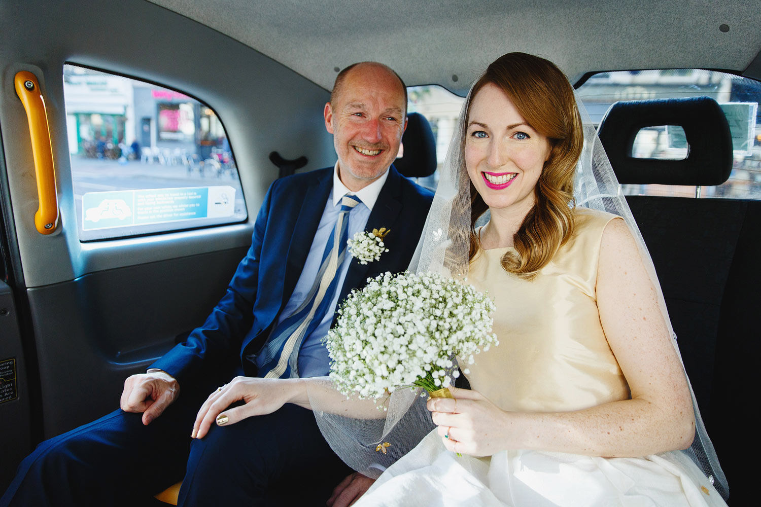 A bride and her father drive to her Islington Town Hall wedding