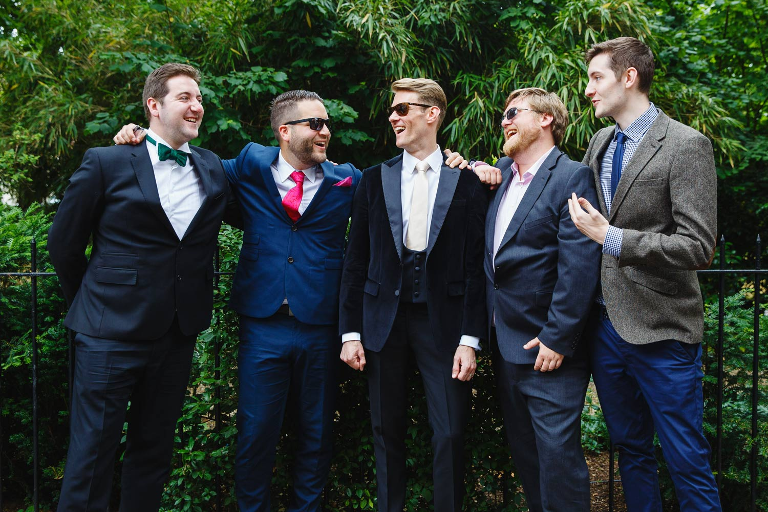 A groom poses with his groomsmen at the Roof Gardens in Kensington - London wedding photographer