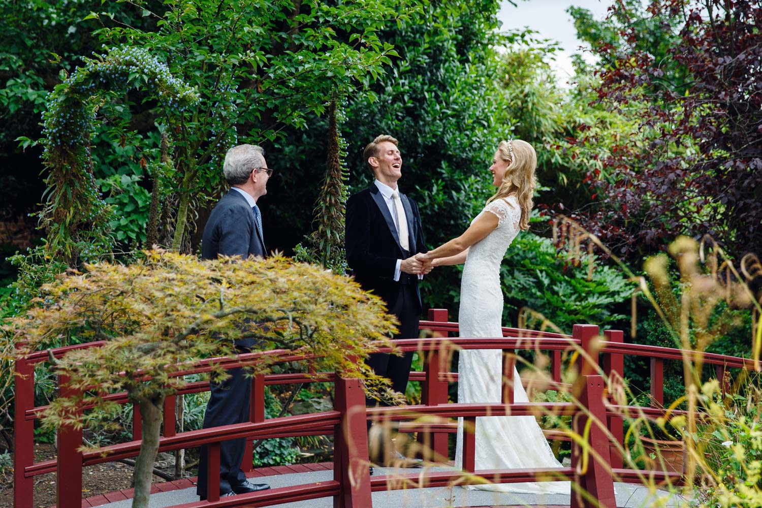 A couple enjoy the ceremony at the Roof Gardens in Kensington - London wedding photographer