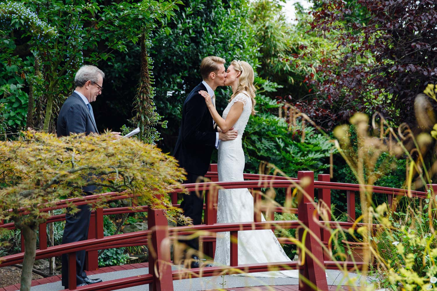 The first kiss during the ceremony at the Roof Gardens in Kensington - London wedding photographer