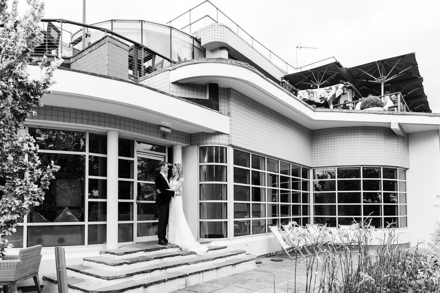 A couple poses for photographs at the Roof Gardens in Kensington - London wedding photographer