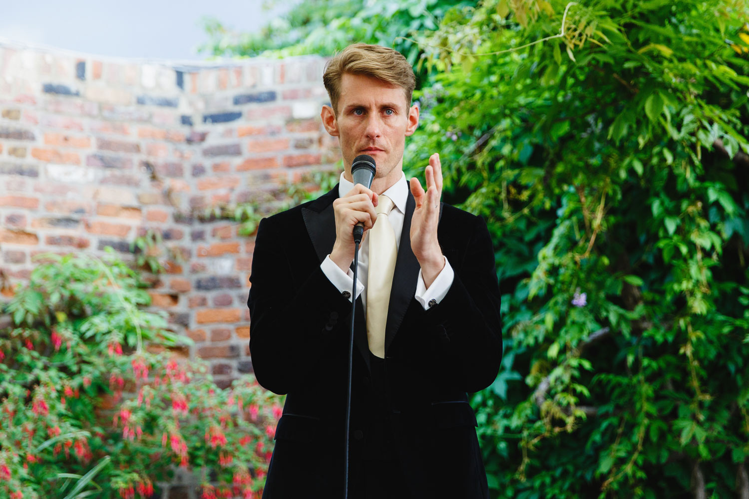 A groom gives his speech at the Roof Gardens in Kensington - London wedding photographer