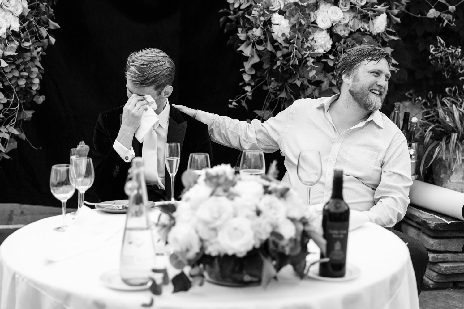 A groom cries during his wife's speech at the Roof Gardens in Kensington - London wedding photographer