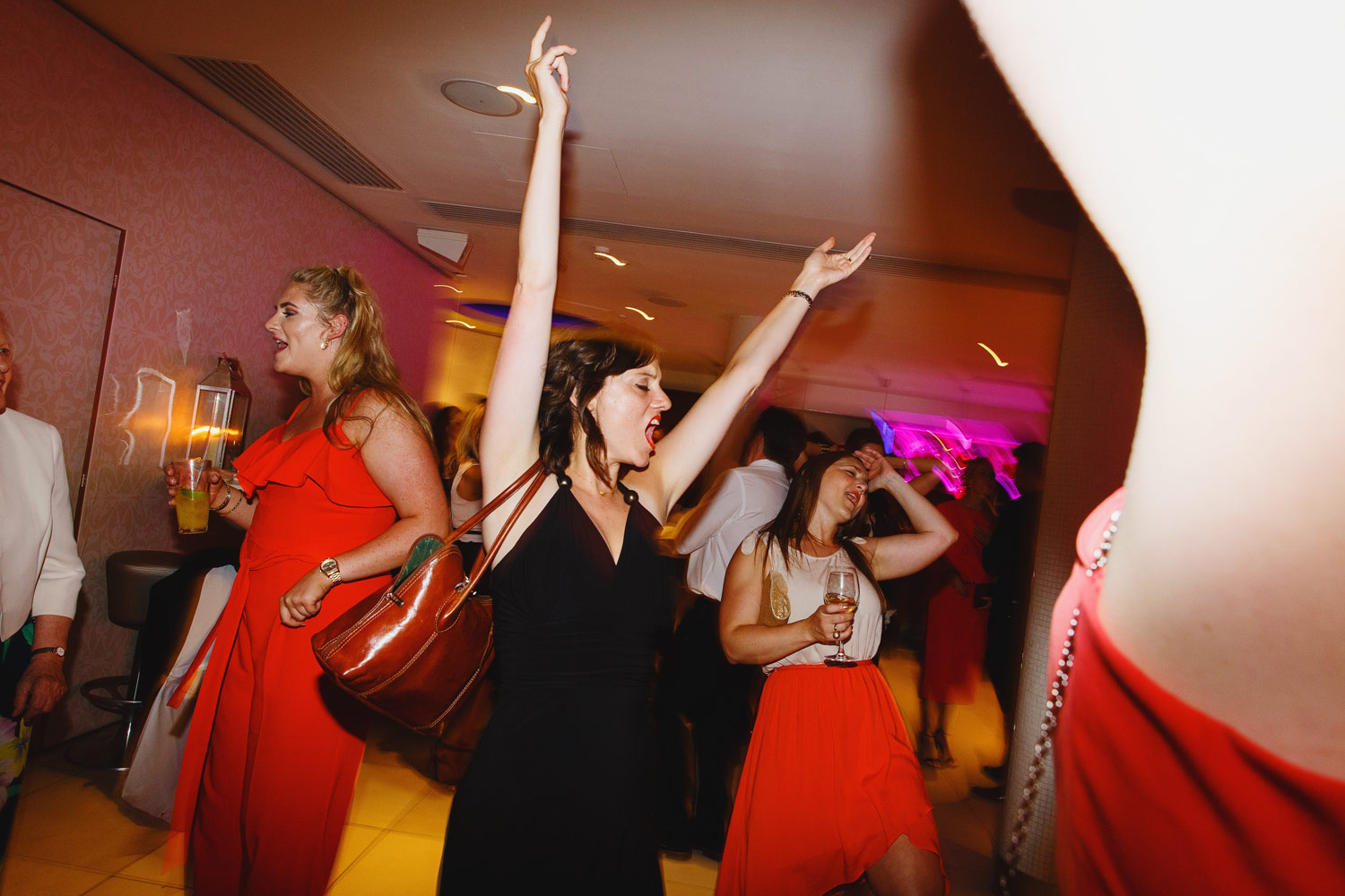 Wedding guests dance at the Roof Gardens in Kensington - London wedding photographer