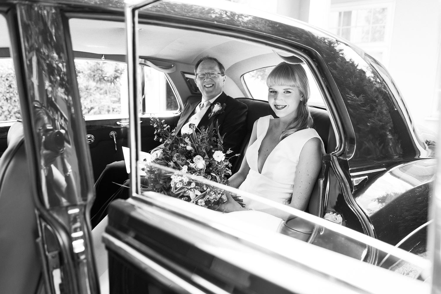Lucy and her father travel to the church for her wedding at the Elvetham Hotel in Hampshire.