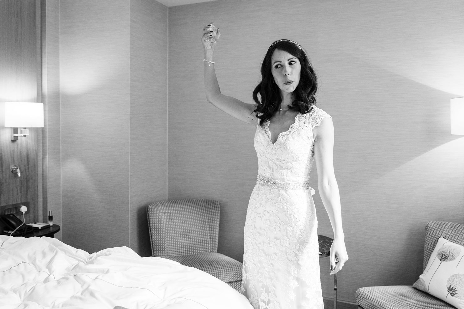 The bride sprays herself with perfume before her wedding at the Conrad St James hotel in London
