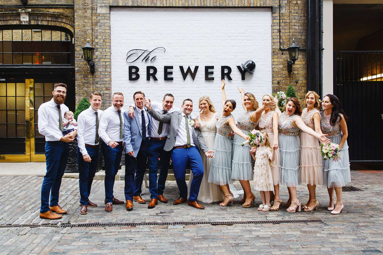A group shot of the wedding party at the Brewery in Moorgate - London wedding photographer
