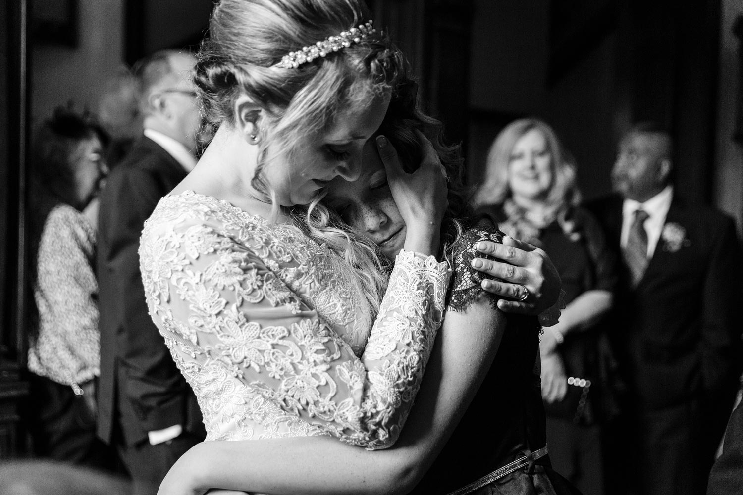 The bride comforts her niece at her wedding at York House in Twickenham