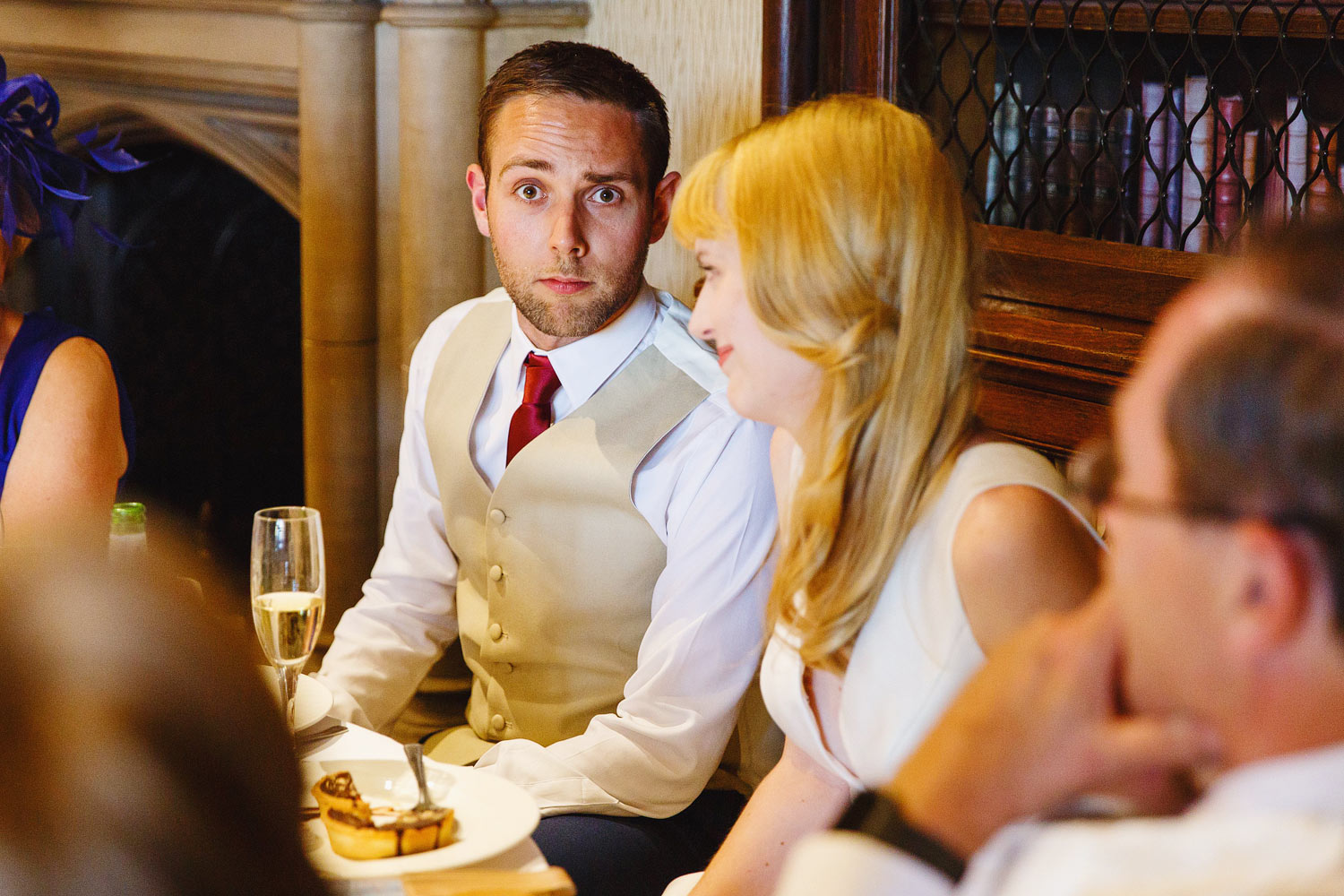 The groom pulls a face at the camera at The Elvetham Hotel