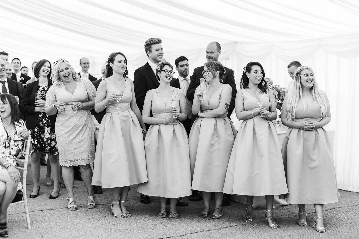 Guests watch the speeches at the Chelsea Physic Garden - London wedding photographer