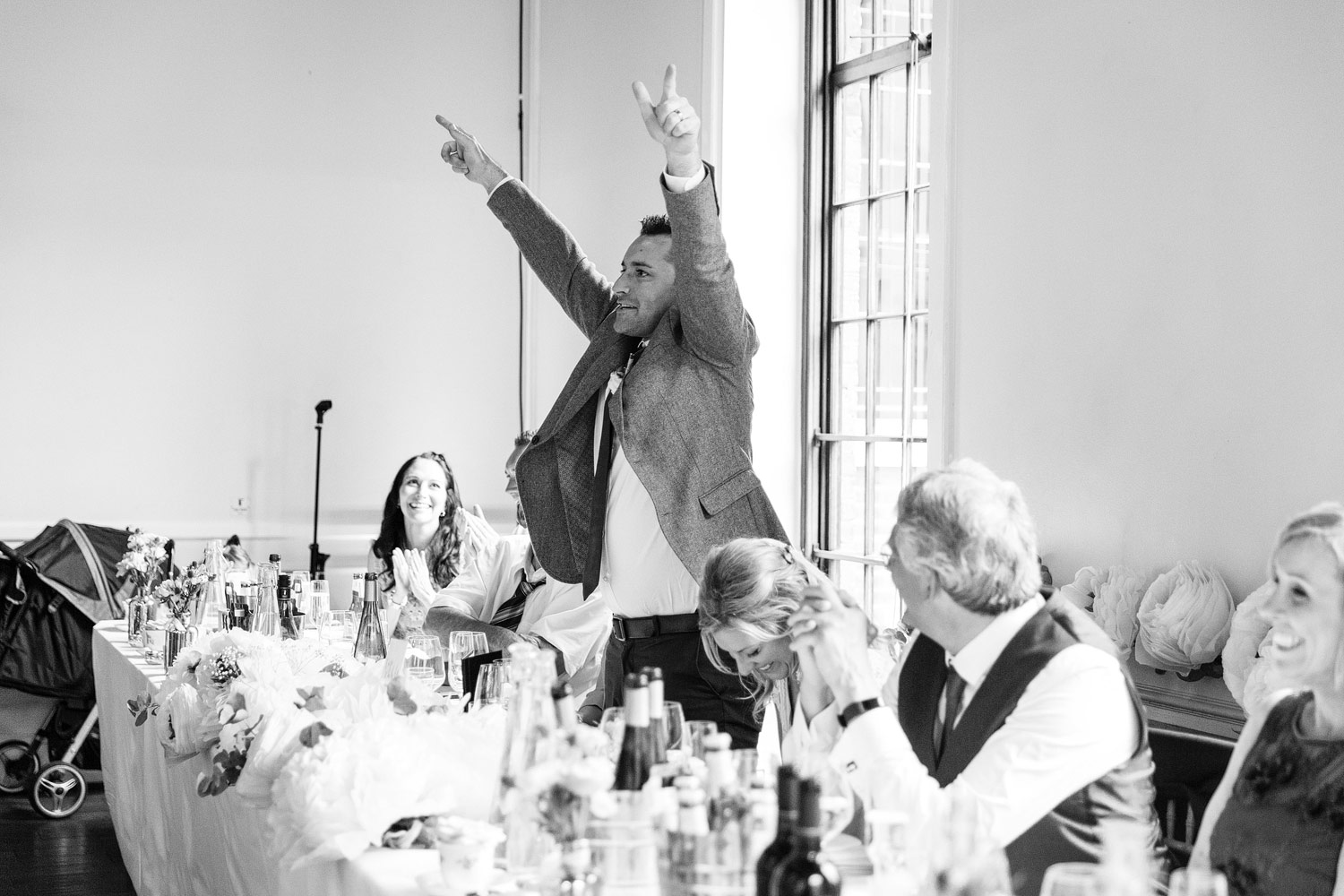 Groom punching the air at his wedding at the Brewery in Moorgate