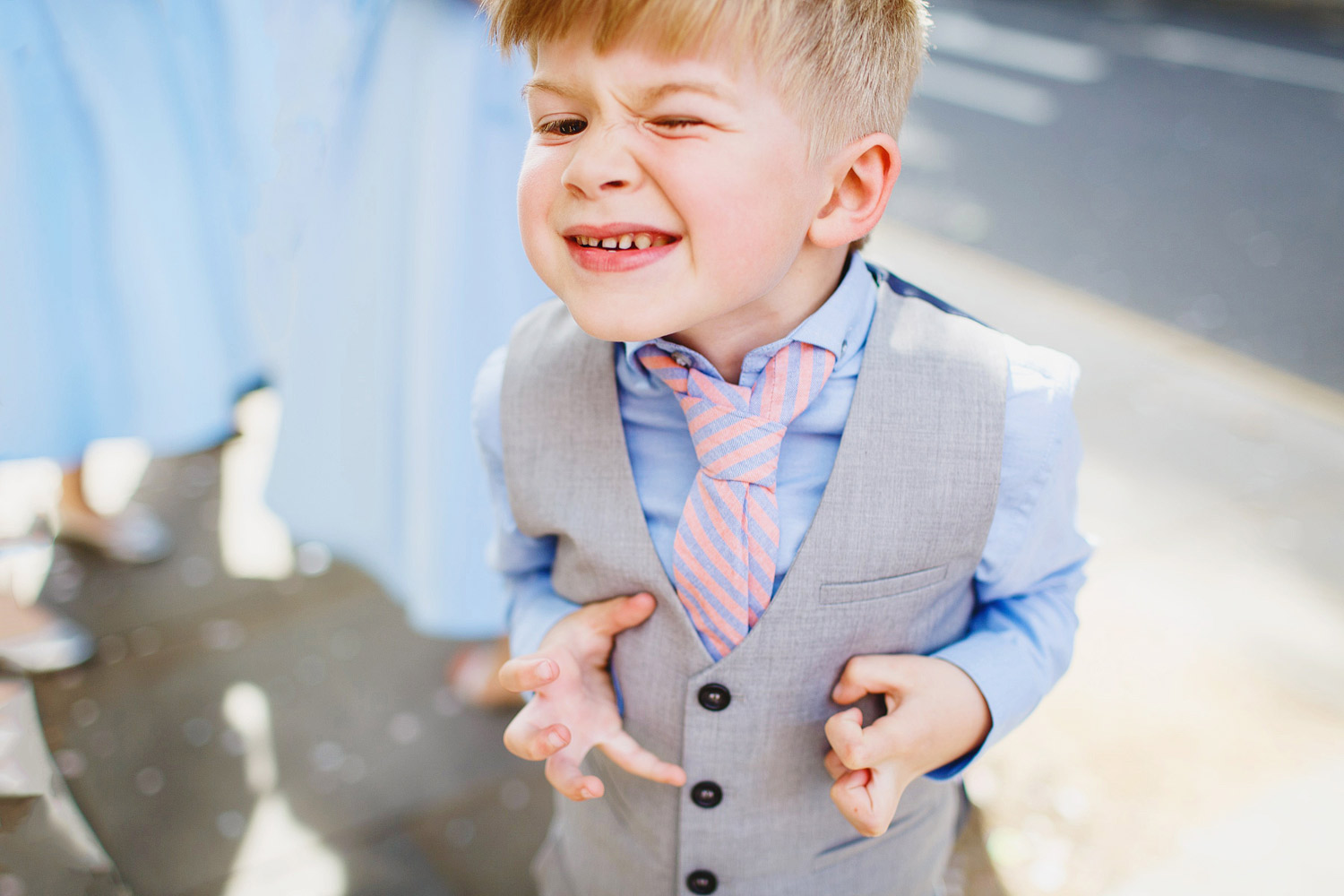 A child pulls a funny face at a wedding at Chelsea Town Hall - London wedding photographer