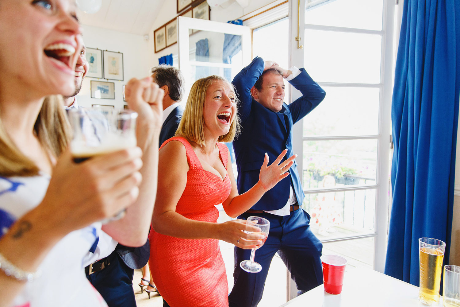 Guests play beer pong at a wedding at Twickenham Rowing Club