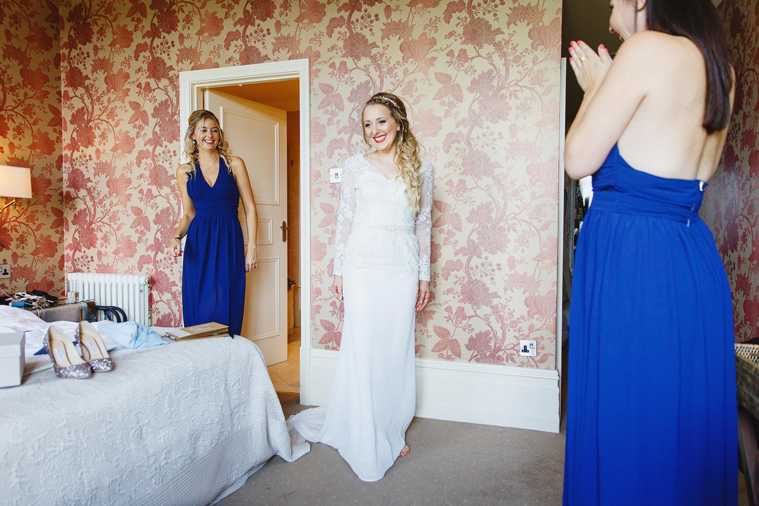 A bride beams in her dress before her wedding at the Petersham Hotel in Richmond