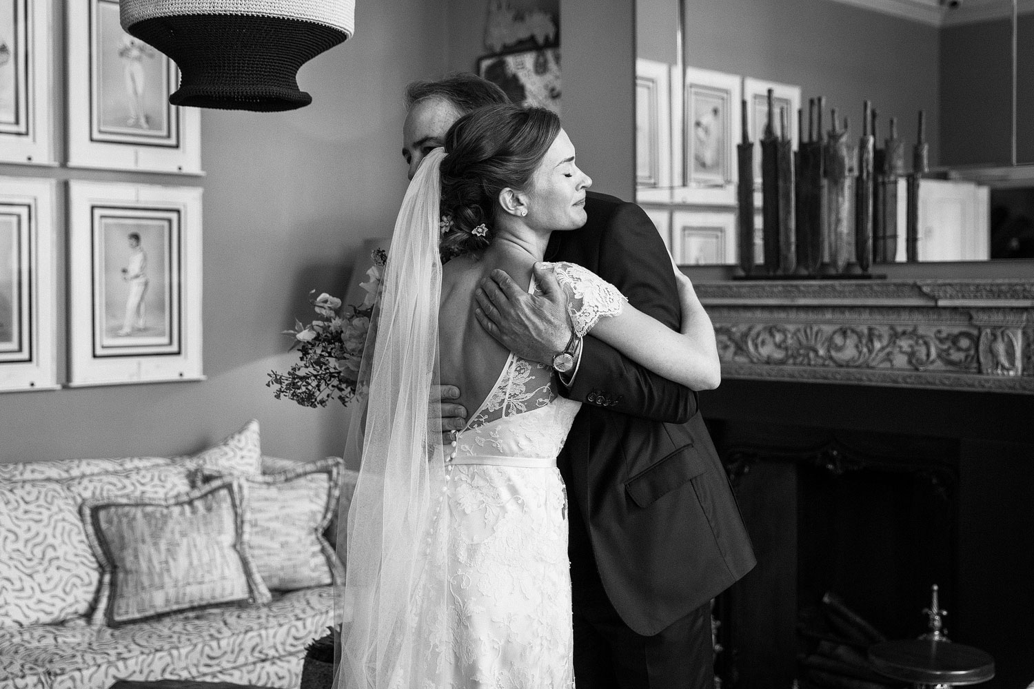 A bride cries while hugging her father at the Dorset Square Hotel before marrying at Burgh house - London wedding photographer