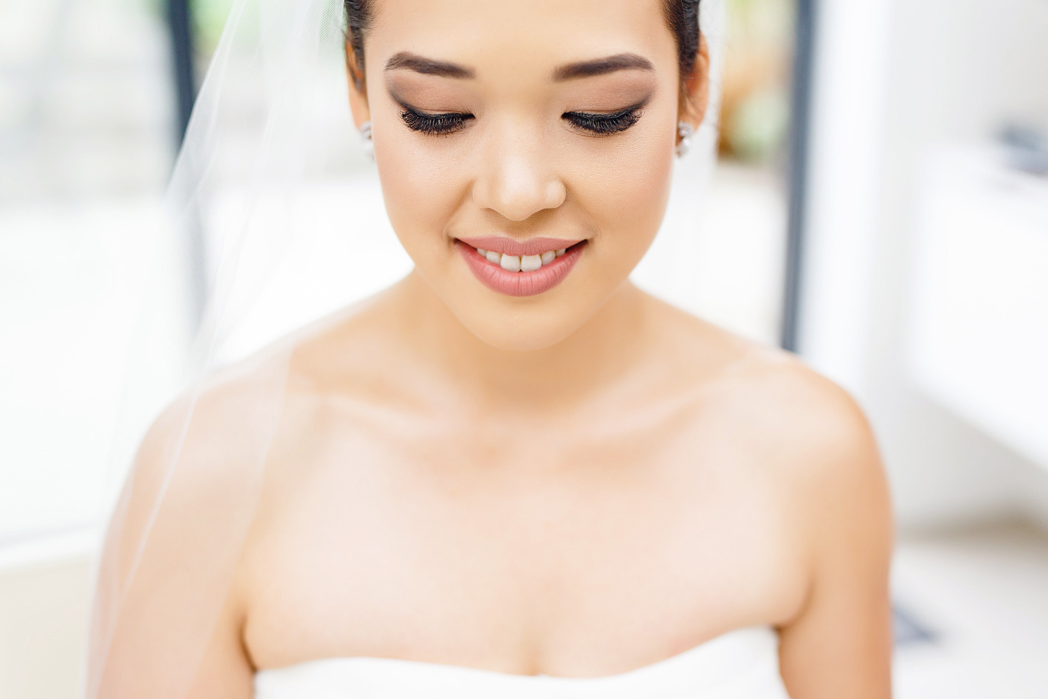A beautiful bride having her make up applied.