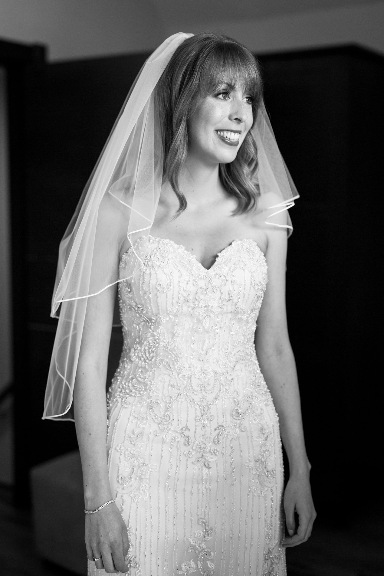 A bride has her make up done at her Northbrook Park wedding - London wedding photographer