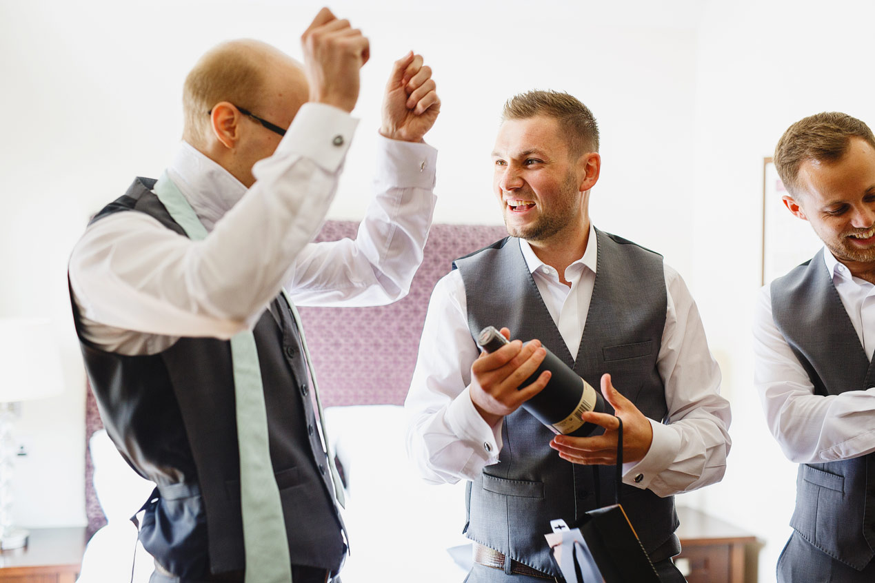 A groom gets dressed before his Northbrook Park wedding - London wedding photographer