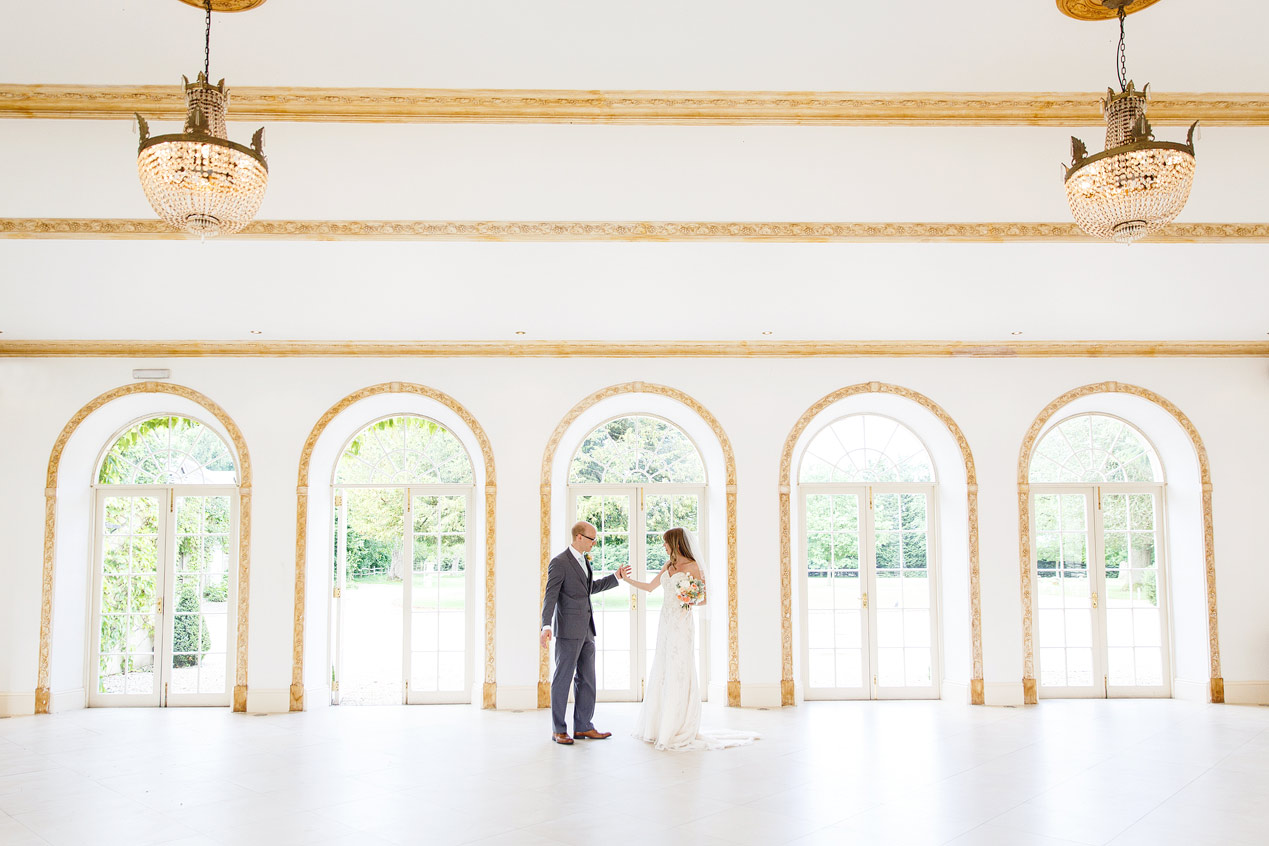 A couple pose for photographs at their Northbrook Park wedding ceremony - London wedding photographer