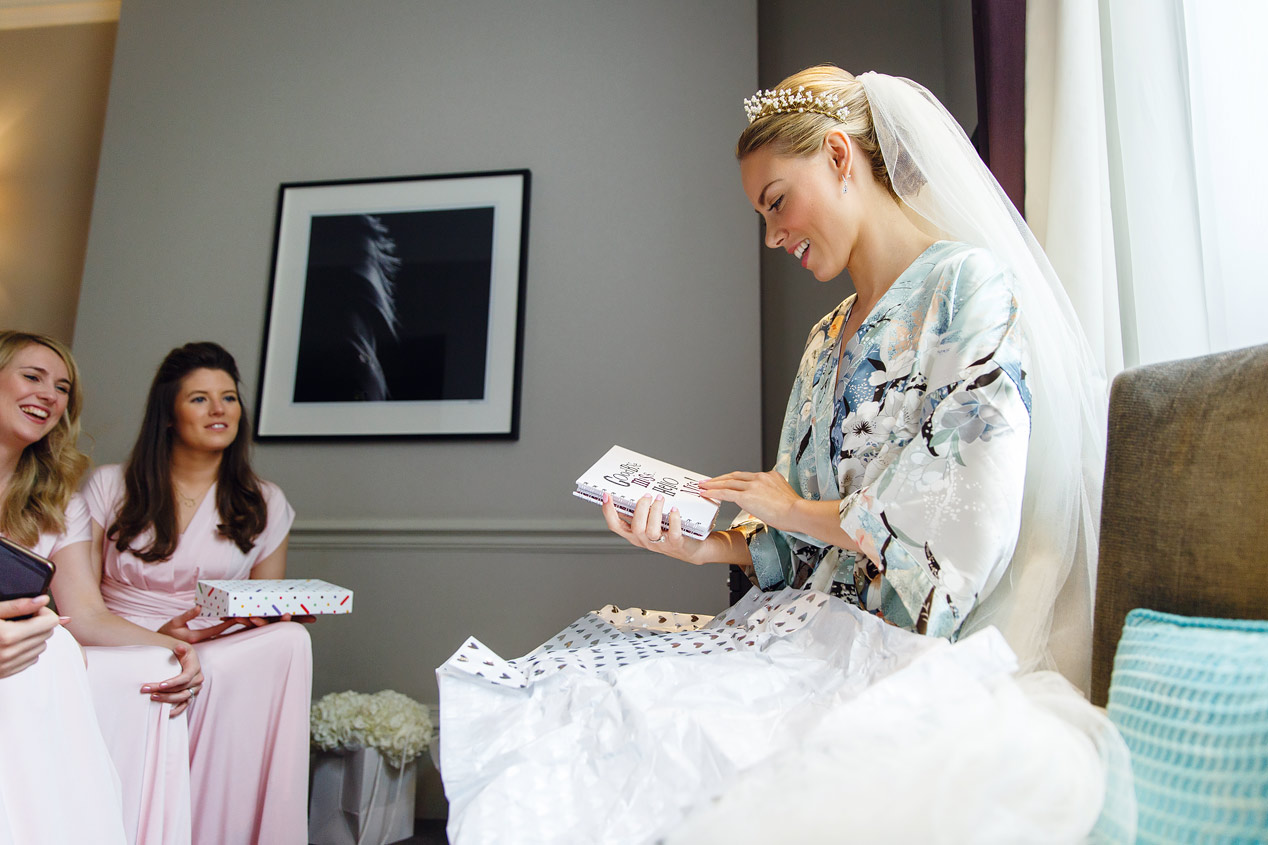 A bride gets her hair and make up done at the Ampersand Hotel - London wedding photographer