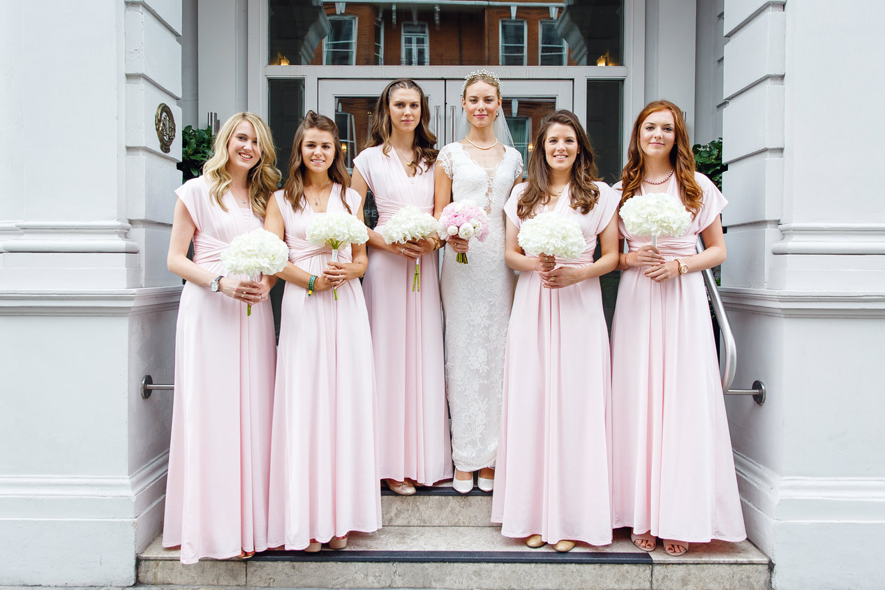 A bride and her bridesmaids pose outside the Ampersand Hotel in Kensington London.