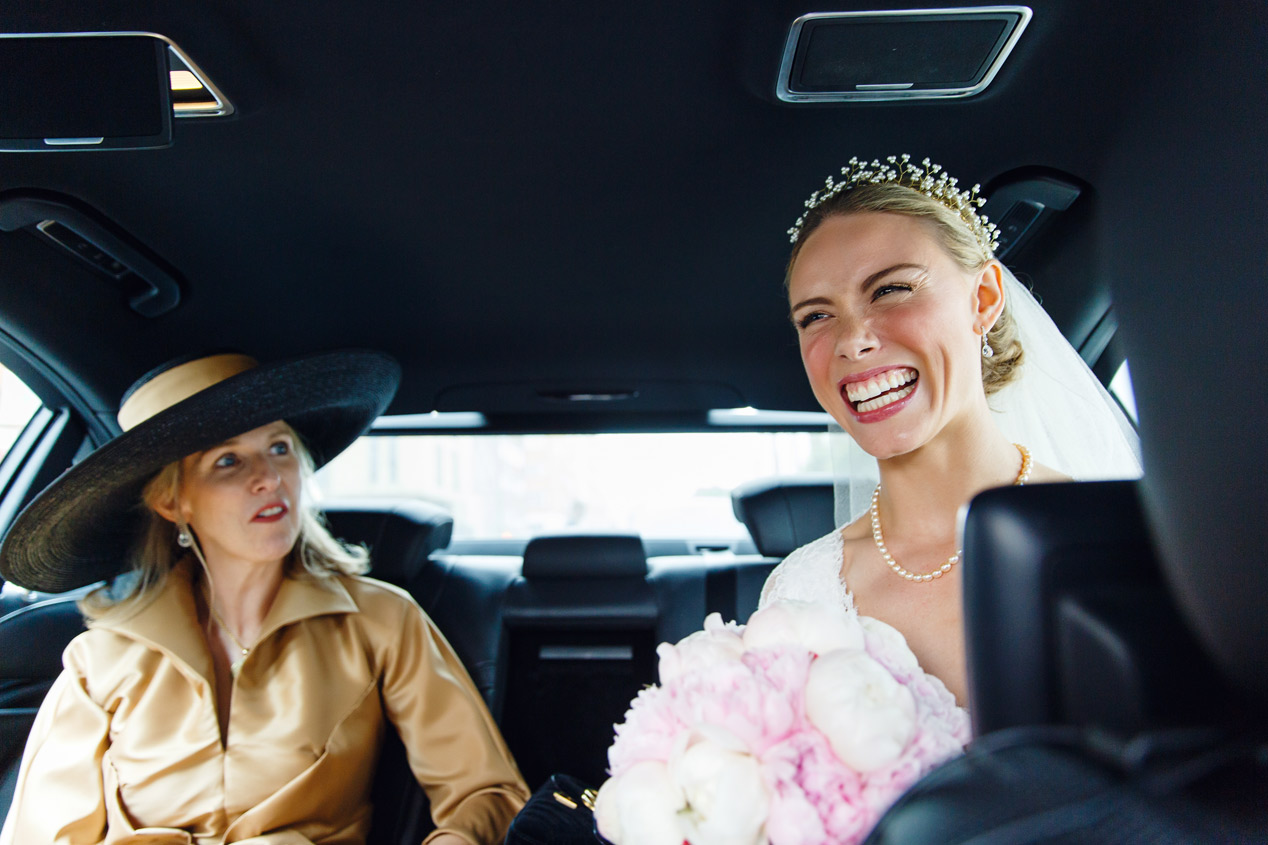 A bride and her mother pose in the taxi outside the Ampersand Hotel in Kensington London.