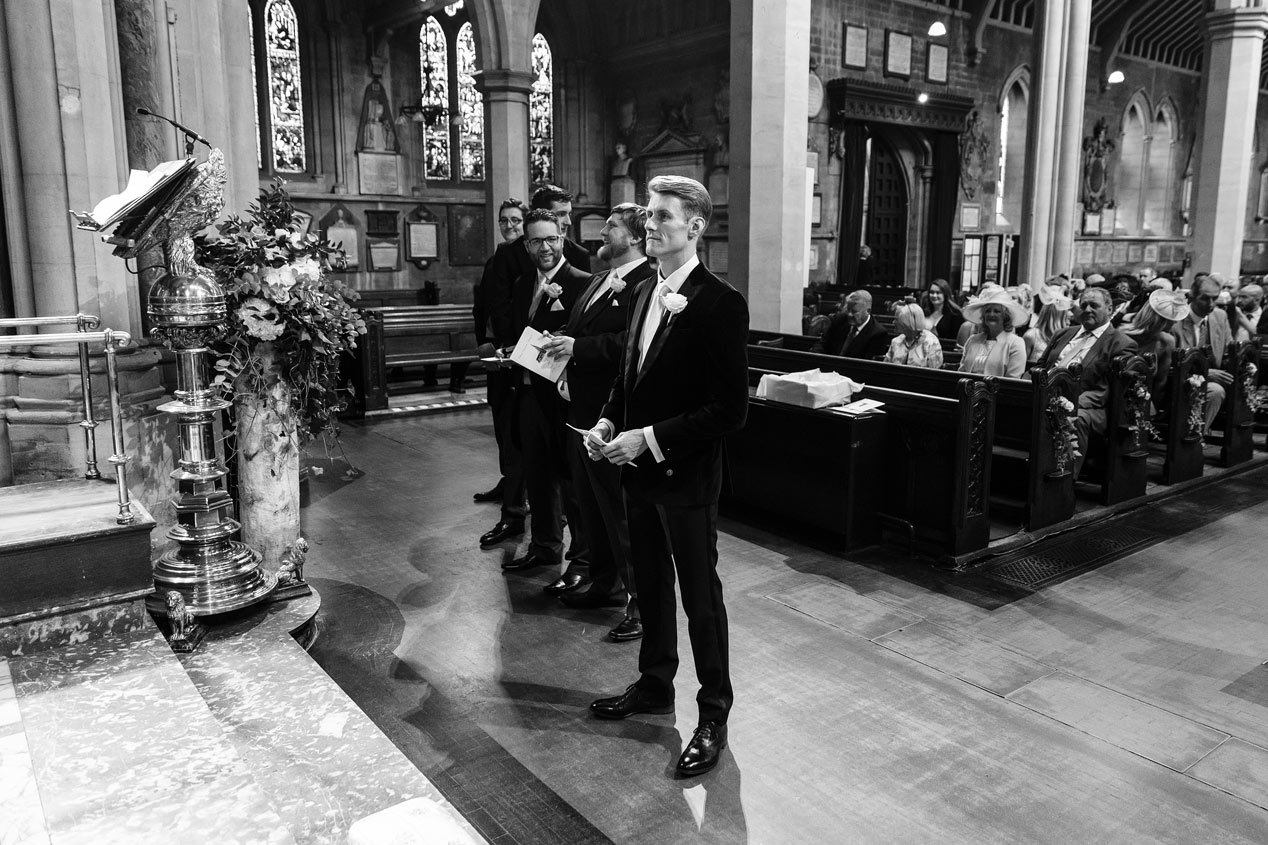 A groom waits at the alter at the St Mary Abbots church in Kensington London.