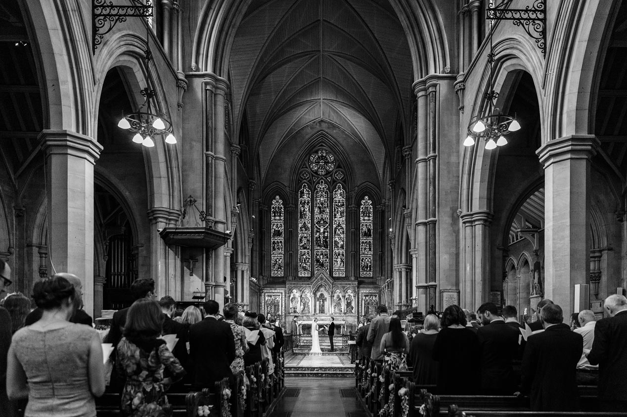 A wedding ceremony at the St Mary Abbots church in Kensington London. Black and white photograph.