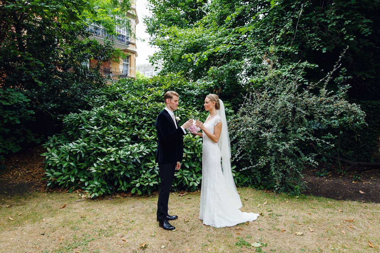 A couple pose for their wedding photographs at The Vicarage in Kensington, London