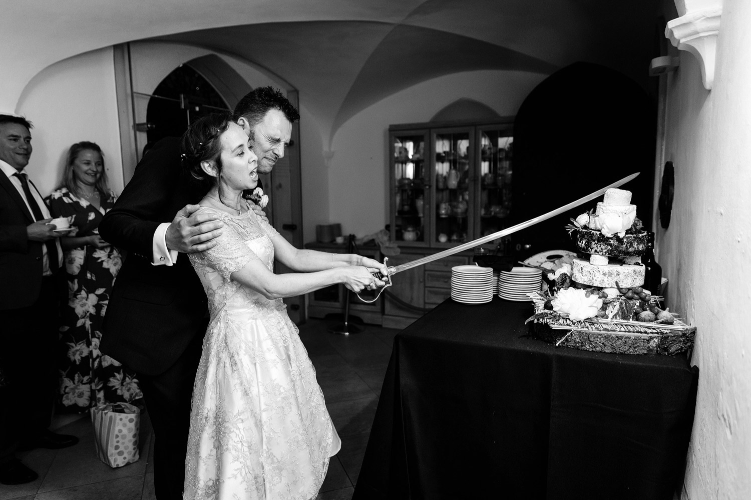 A bride and groom cut the cake at their Strawberry Hill House wedding in Twickenham