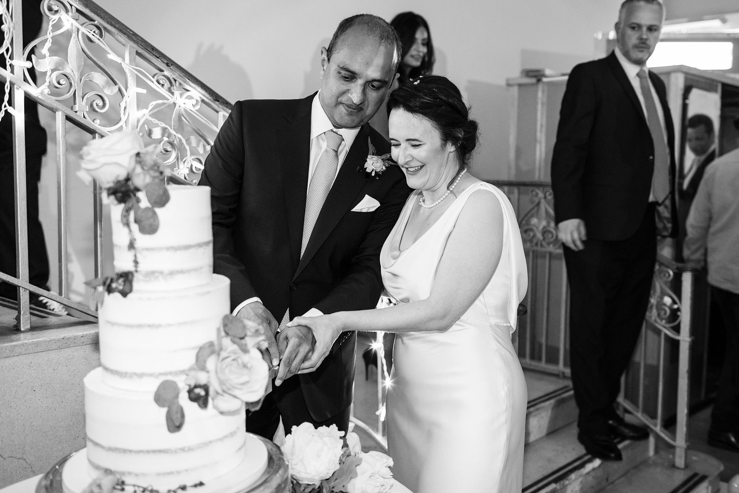 a bride and groom cut their cake at Sunbeam Studios