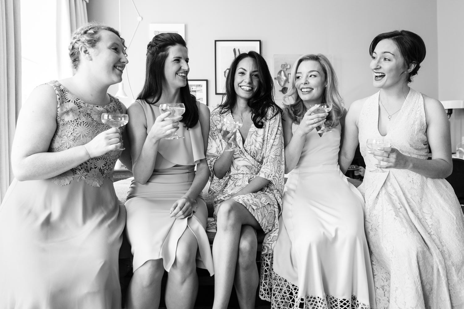 A bride and her bridesmaids pose at The Laslett Hotel in London