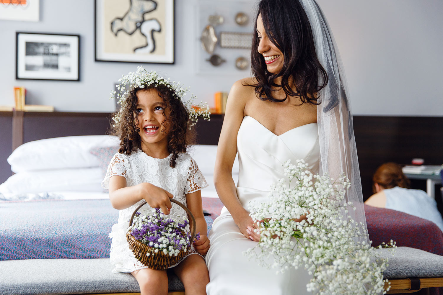 A bride sits with her flowergirl at The Laslett Hotel in London - wedding photographer