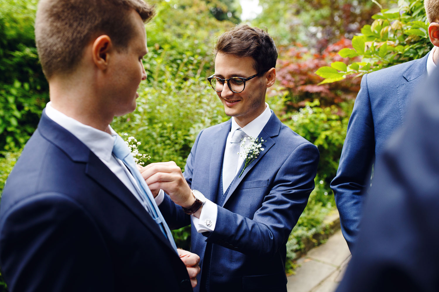 A groom gets ready outside Burgh House Museum in Hampstead, London - wedding photographer