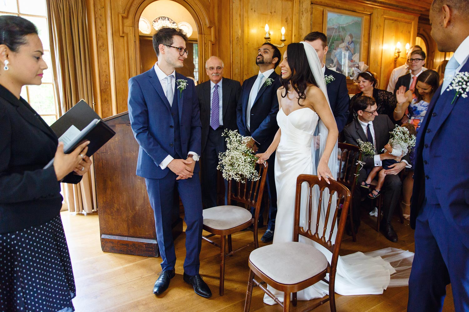 A bride walks down the aisle at Burgh House Museum in Hampstead, London - wedding photographer
