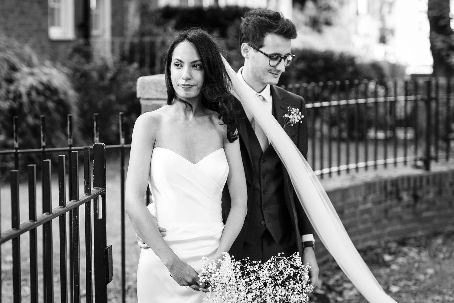 A black and white photograph of a newly married couple posing at Burgh House Museum in Hampstead, London - wedding photographer