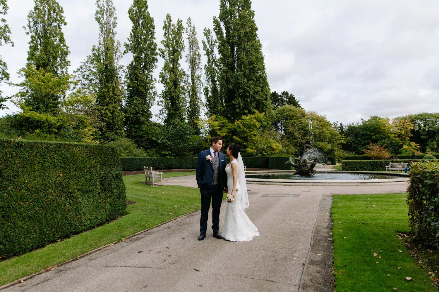 A couple pose in Regents park on the way to their Langham Hotel wedding