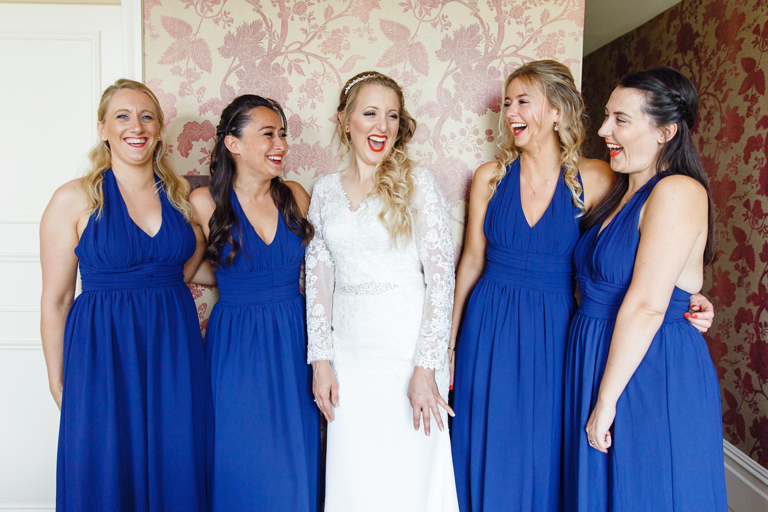 A bride and her bridesmaids pose at The Petersham Hotel before her wedding at York House in London.