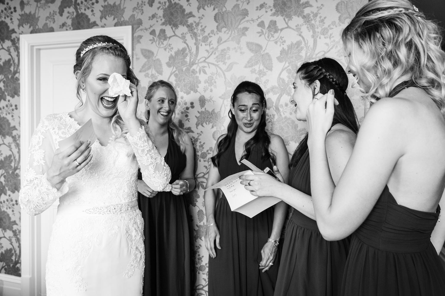 A bride cries as she reads a letter from her fiance at The Petersham Hotel before her wedding at York House in London.