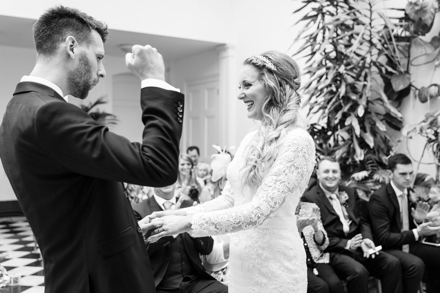 A groom punches the air during his wedding ceremony at York House in Twickenham, London.