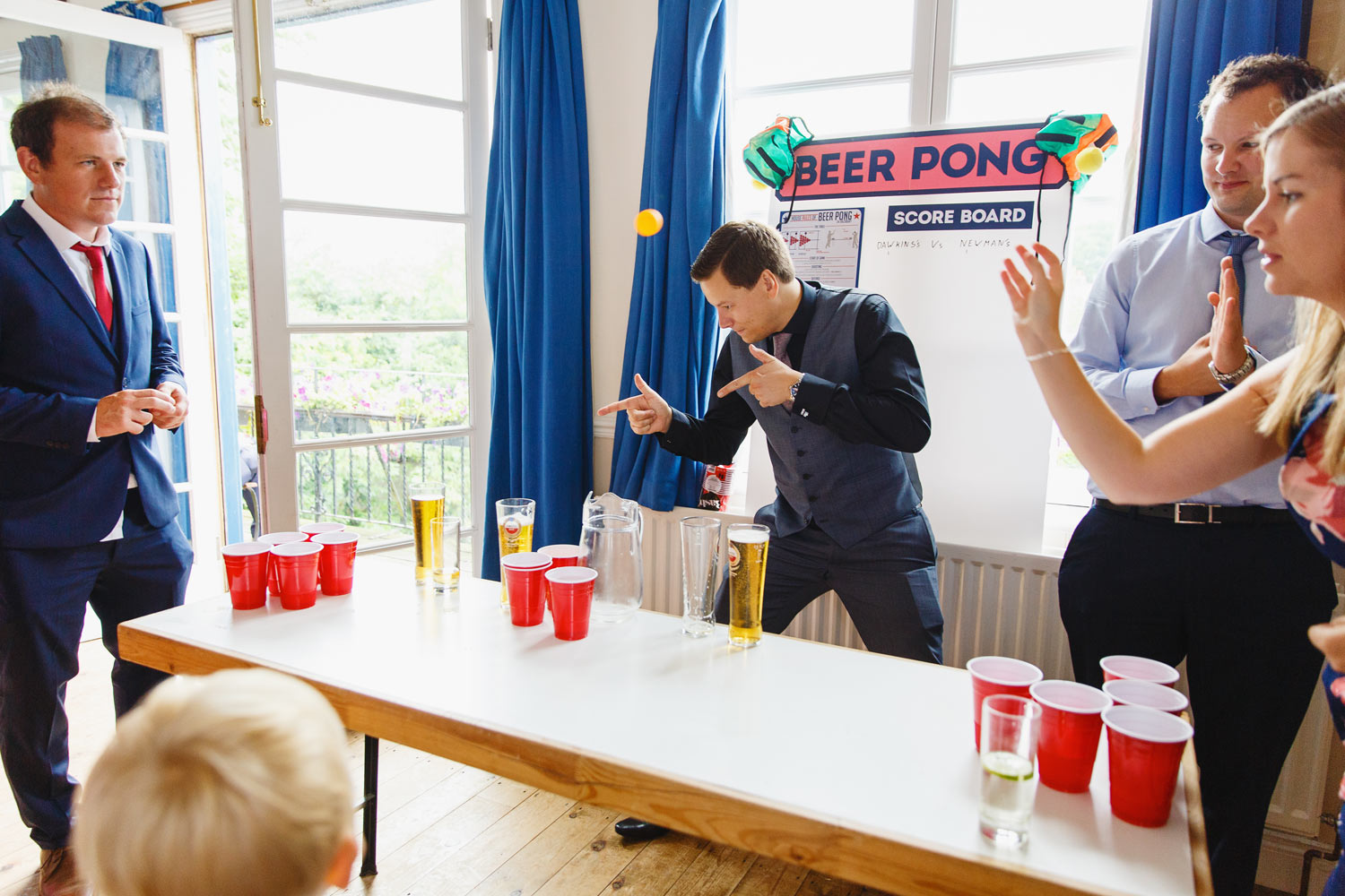 Wedding guests play beer pong at the Twickenham Rowing Club, London.
